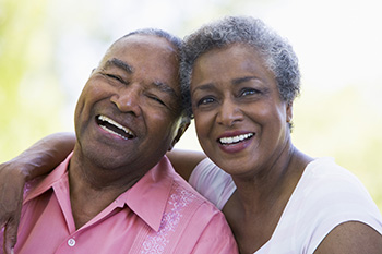 Happy retired couple laughing