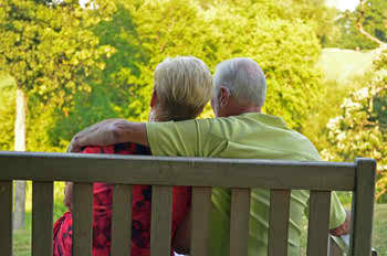 Relaxed Couple sitting by the nature talking about Medicare plans