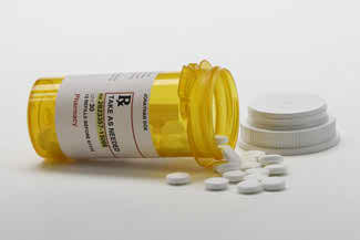 Medicare Drug Plans presented with an open bottle of pills
