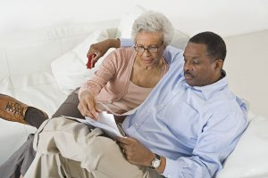 A son and his elderly mom reading some information on what is Medicare Advantage